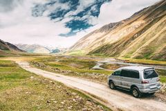 SUV Car On Off Road In Spring Mountains Landscape In Truso Gorge royalty free stock image