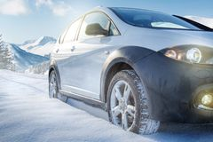 SUV car on snow covered mountain road. Lights Royalty Free Stock Image