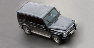 Suv car from top. Luxury SUV on road isolated Part of my luxury cars series Royalty Free Stock Image