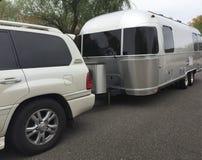 SUV Car towing camper van holiday vacaction Royalty Free Stock Photography