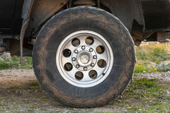 SUV car wheel on dirty rural road Stock Photography