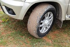 SUV car wheel with light alloy disc. On dirty country ground, close-up photo Stock Photo