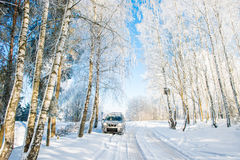 Suv car in winter day Royalty Free Stock Photo