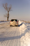 SUV car winter road Royalty Free Stock Photo