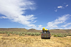 SUV Car With Yellow Kayaks In Desert Royalty Free Stock Photography