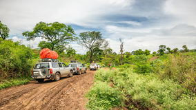 SUV cars on an expedition in the rainforest of Ethiopia. OMO VALLEY, ETHIOPIA - MAY 3, 2015 : SUV cars on an expedition in the rainforest of southern Ethiopia Royalty Free Stock Photo