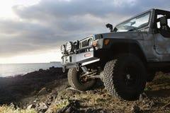 SUV at Coast Stock Photo