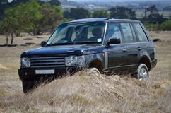 SUV in the country. 4x4 SUV on country route Stock Images