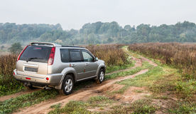 Suv in countryside road Royalty Free Stock Photography