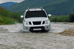 SUV crosses the river Royalty Free Stock Photography