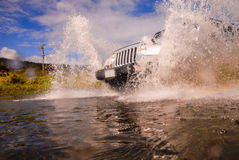 Suv in crossing river Royalty Free Stock Image