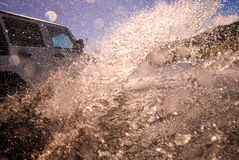 Suv in crossing river Stock Image