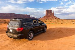 SUV in the desert of Monument Valley Stock Images