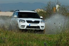 Suv drives through water Stock Images