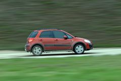 Suv driving on country road Royalty Free Stock Image