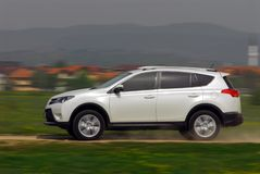 Suv driving on country road Royalty Free Stock Images