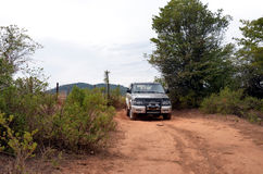 SUV driving on dirt road Royalty Free Stock Images