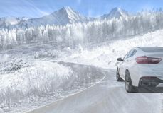 SUV driving on a mountain road during falling snow Royalty Free Stock Photos