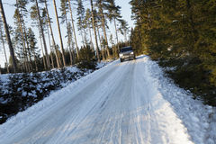 Suv, driving on small snowy road Royalty Free Stock Photo