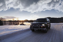 Suv, driving through winter scenery Stock Photo