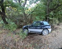 The SUV car crashed off the road in Georgian mountains royalty free stock photography