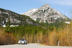 Suv e montanhas Imagem de Stock Royalty Free