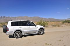 SUV exploring Anza Borrego Desert royalty free stock photos