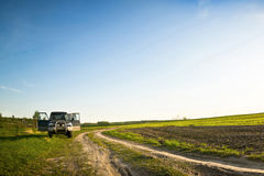 Suv in field Stock Image