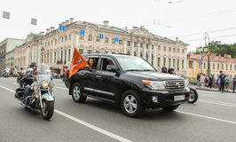 The SUV with the flag of the sponsoring company. Stock Image