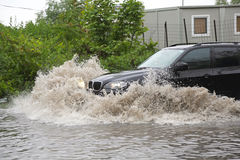 SUV in flood Stock Photos