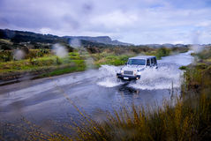 SUV fording river Stock Photo