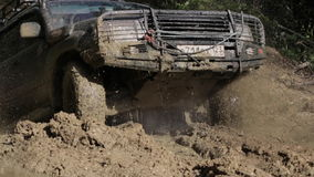 SUV got stuck in the deep trench with dirty water and trying getting out. stock footage