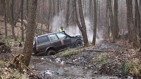 SUV got stuck in the mud in the forest, off-road stock video footage