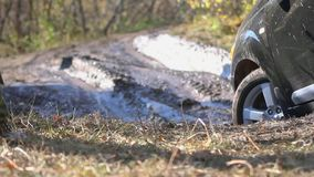 SUV got stuck in the mud and trying to go out in. The autumn forest. HD. 1920x1080 stock footage