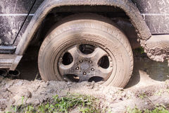 SUV got stuck in the mud, wheel closeup Royalty Free Stock Photo