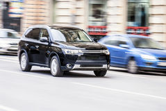 SUV on high speed in the city... Stock Images