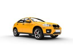 SUV jaune - vue de côté Photos stock