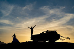 SUV and marital happiness. Wedding concept;Bride and groom light concept.celebration of marriage in nature.SUV and marital happiness Stock Photography