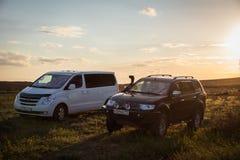 SUV Mitsubishi Pajero Sport and Hyundai H-1 GRAND STAREX,. Kalmykia region, Russia. 04-16-2016 Stock Photography