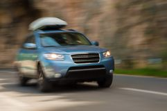 SUV in motion Stock Images