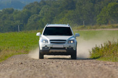 SUV on a mountain road Stock Photos