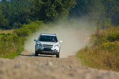 SUV on a mountain road Royalty Free Stock Image