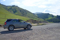 Suv in the mountains Stock Photo