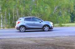 SUV moves on the country road Stock Photo