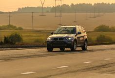 SUV moves on the country road Stock Images