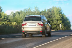 SUV moves on the country road Royalty Free Stock Image