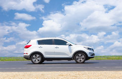 SUV moves on the highway Stock Photography