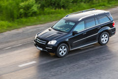 SUV moves on highway Stock Photos