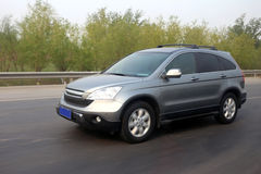 Suv. Moving suv in the highway stock photography