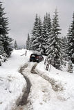 SUV moving on winter road Royalty Free Stock Images